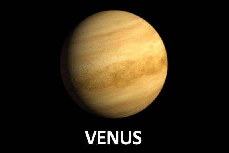 Picture of the planet Venus appearing yellow against a dark sky